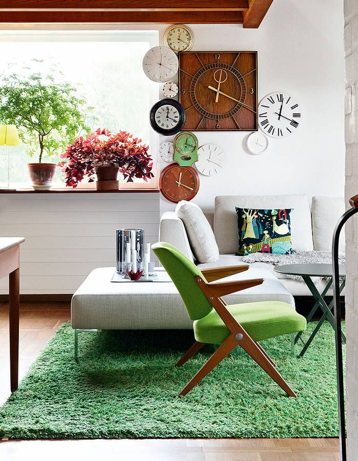 colour scene for the livingroom -brown sofa, IKEA rug, green stools, add white and teak/acacia wood tones and a touch of black and gold/brass as accents