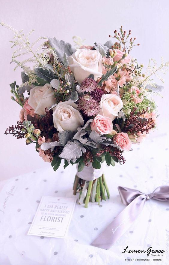 You Re Probably Familiar With Some Of The Most Common Wedding Flower Arrangements Colorful Wedding Bouquet Wedding Flower Arrangements Flower Bouquet Wedding
