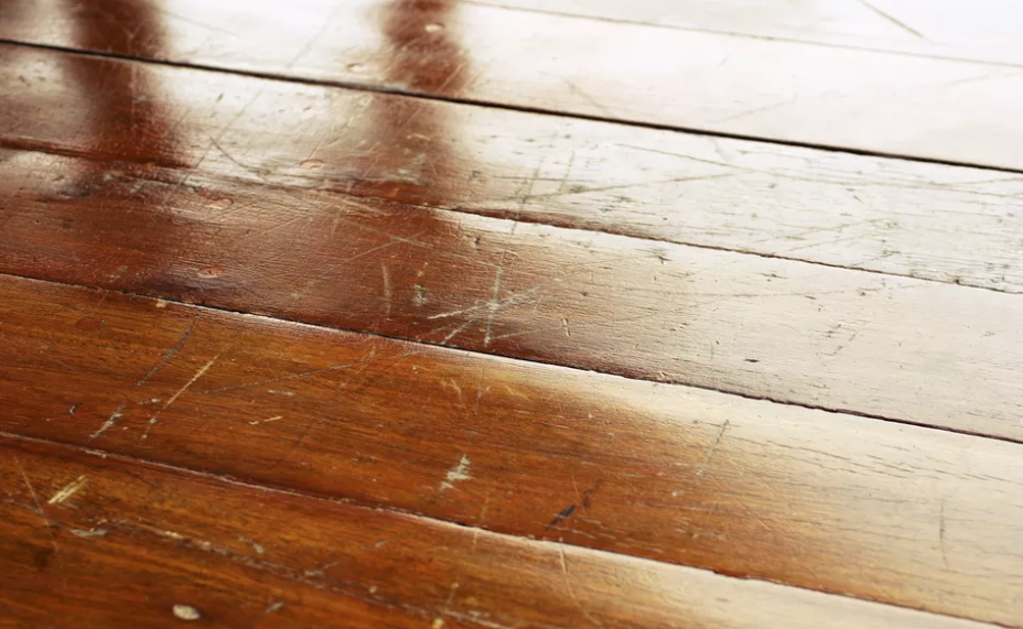 How To Deal With Scratched Wood Floors Scratched Wood Floors Natural Wood Flooring Scratched Wood