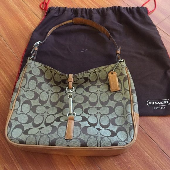 """Coach purse Used coach purse - the leather has darkened a bit. The bottom shows some wear (noted above in the photo). Purse clips shut.  Dimensions are about 10"""" x 8"""" x 2 1/4"""". Still has some life left. bundle and save! Coach Bags Shoulder Bags"""