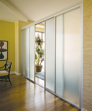 Frontal View Of A Sliding Door With Metal Frame And Semi Opaque Gl