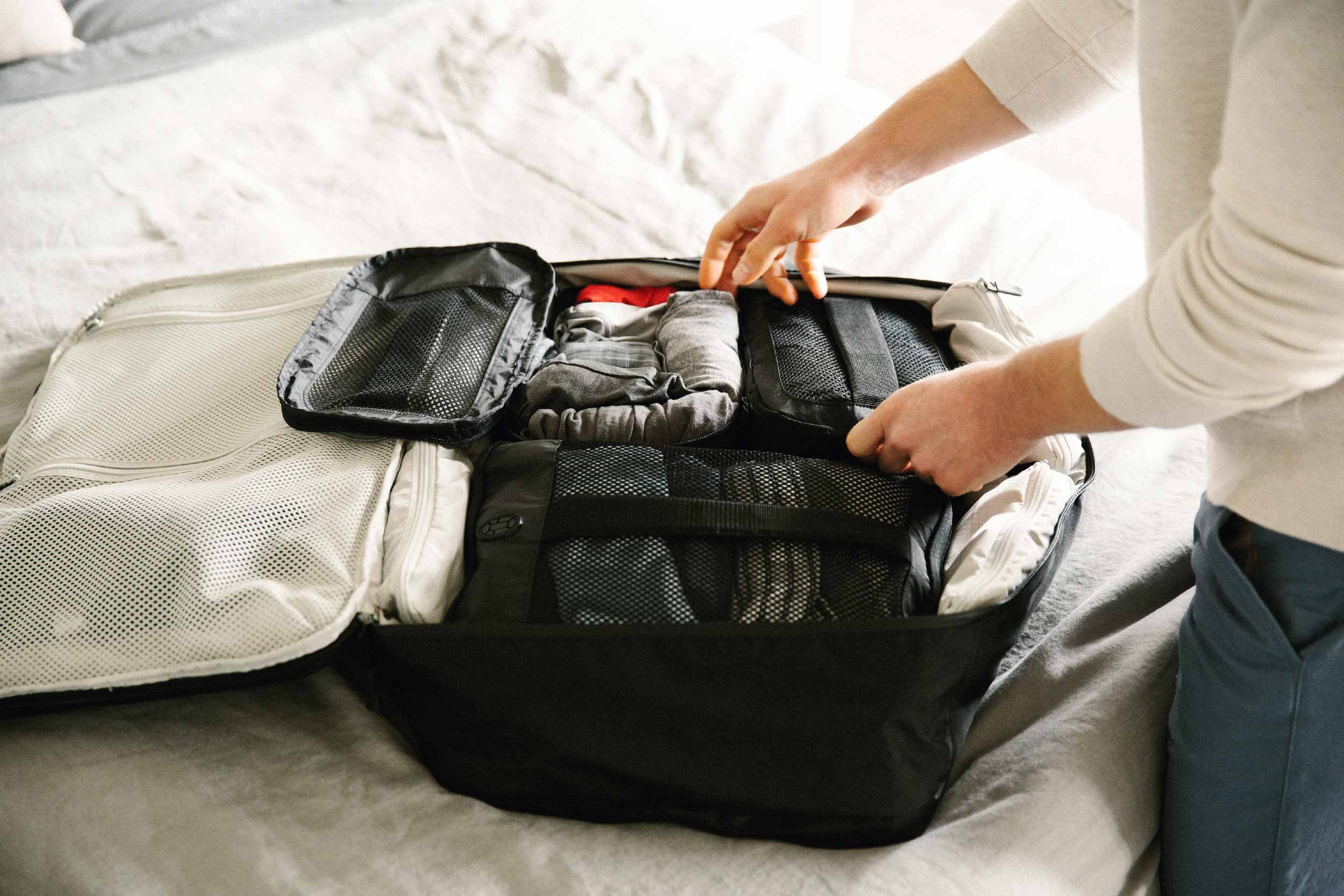 The Definitive Carry On Packing List Tortuga Rolling Clothes For Packing Packing Tips For Travel Packing Tips
