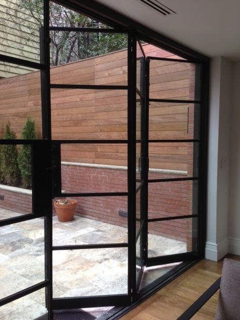 Manhattan Brown Stone Steel Bi Fold And Steel French Doors Steel Doors And Windows Door Glass Design Door Design