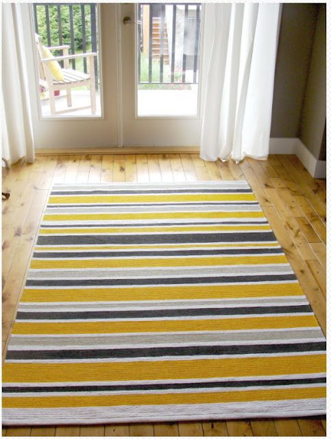Create your own rug: buy a cheap white rug from IKEA and go to town with paint