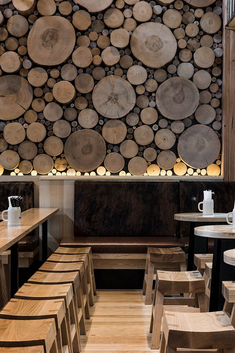 A giant log wall is a focal point in this restaurant in for Focal point flooring