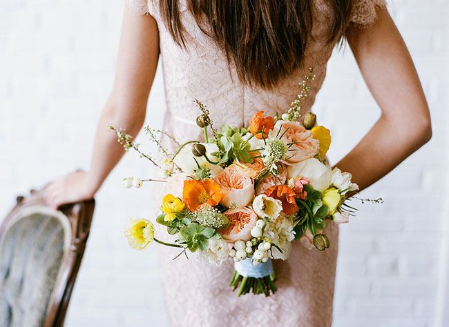 love this bouquet of poppies, scabiosas, garden roses and ranunculus by Janie Medley Flora Design