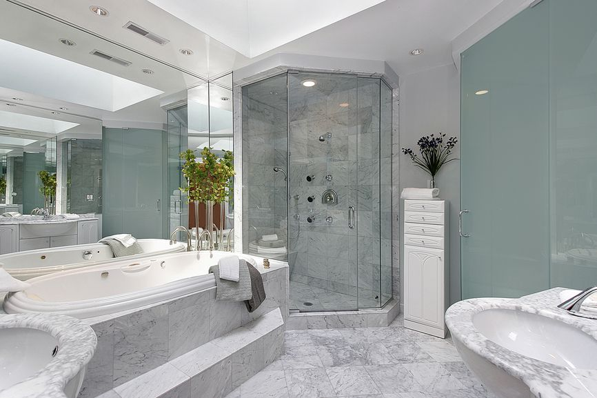 Grey, white and aqua green make up this cool looking bathroom design. Extensive marble give it a luxurious design.