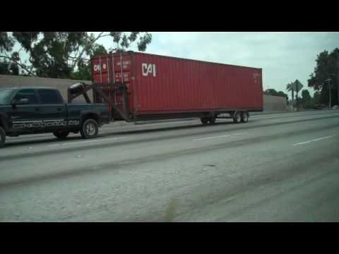 Chevy 5th wheel pulling a container - YouTube