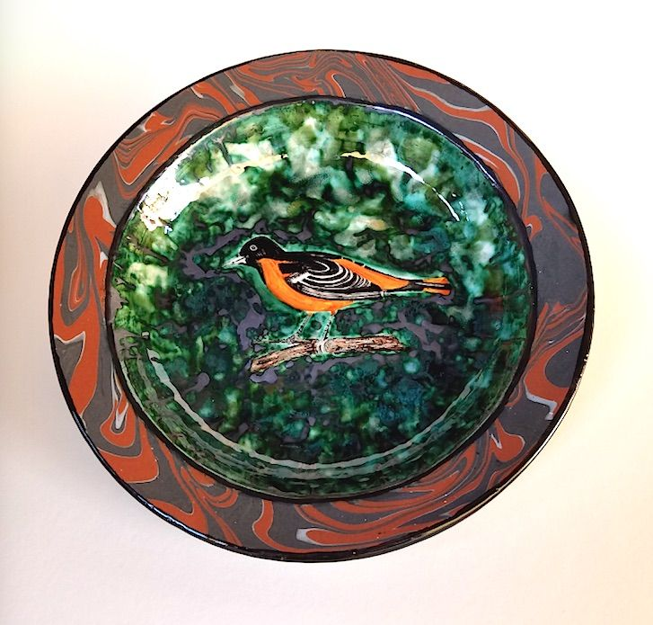 """Earthenware platter with hand painted Baltimore Oriole in a copper green field and rim a ring of marbled slips. """"14 diameter"""