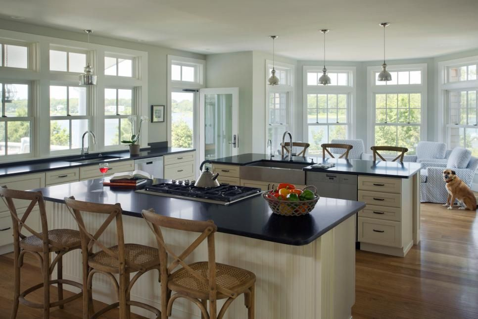 Elegant Kitchen: Light Walls And White Cabinets Create A Bright, Breezy Atmosphere  In This Coastal Kitchen, Which Fits Perfectly With This Home. Part 13