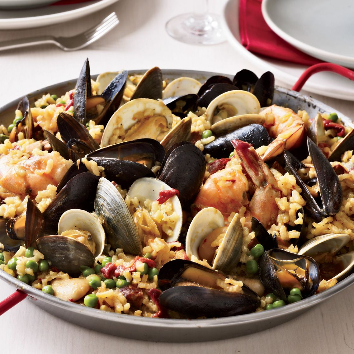 Paella valenciana recipe paella seafood paella and wine chef way seamus mullen cooks the rice for this chicken and seafood paella as forumfinder Images