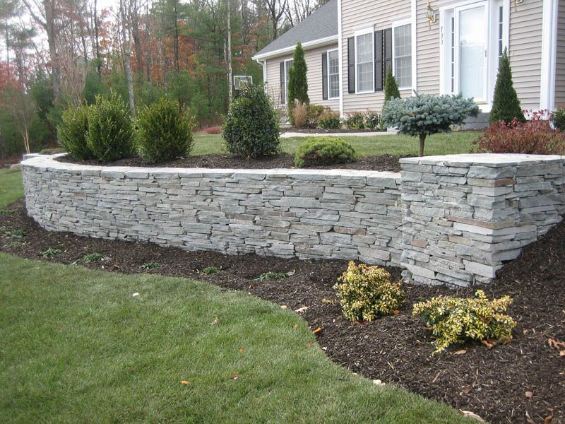 Bluestone retaining walls manchester nh bluestone for Block wall landscape design