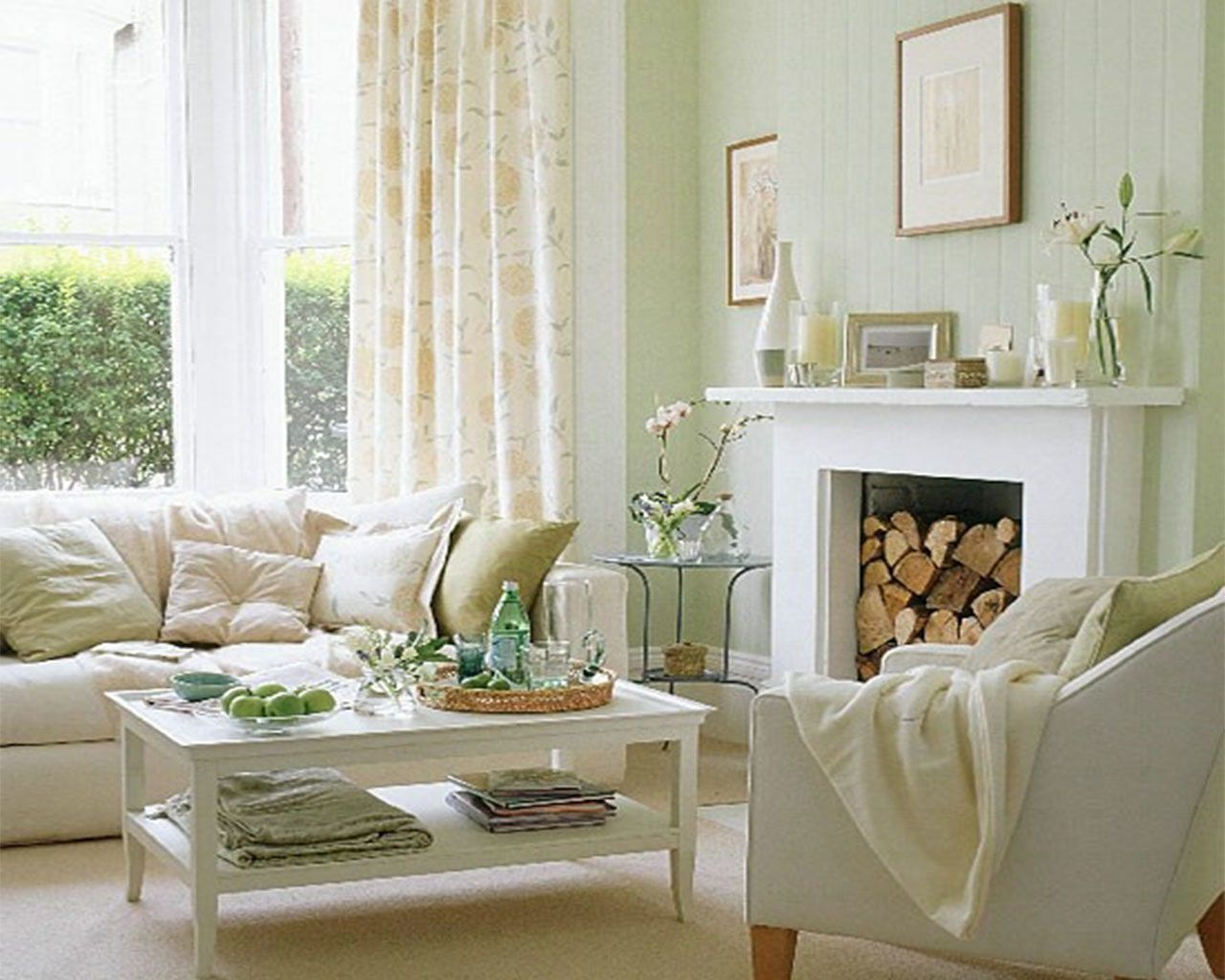 Creamy white living room with accents of very light green - Green living room ideas decorating ...