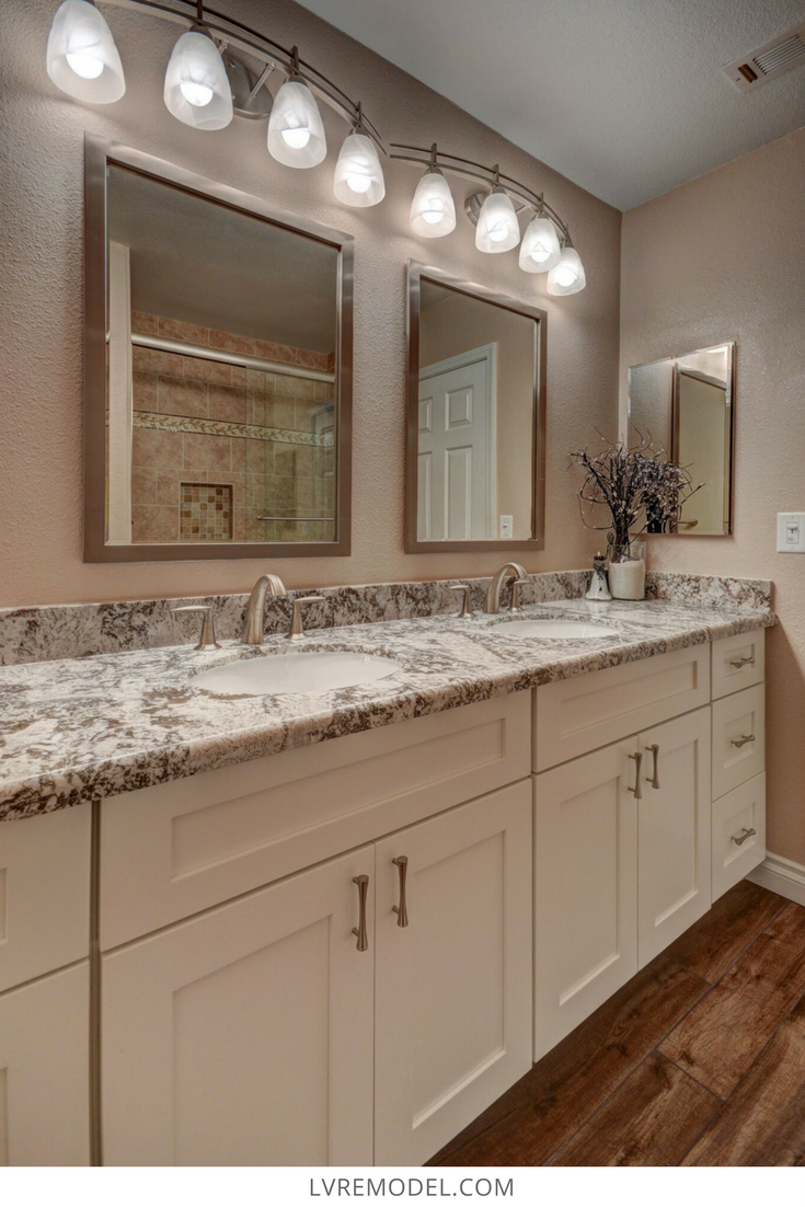 Beautiful Bathroom Counter Top With Cream Colored Cabinets In Las Vegas