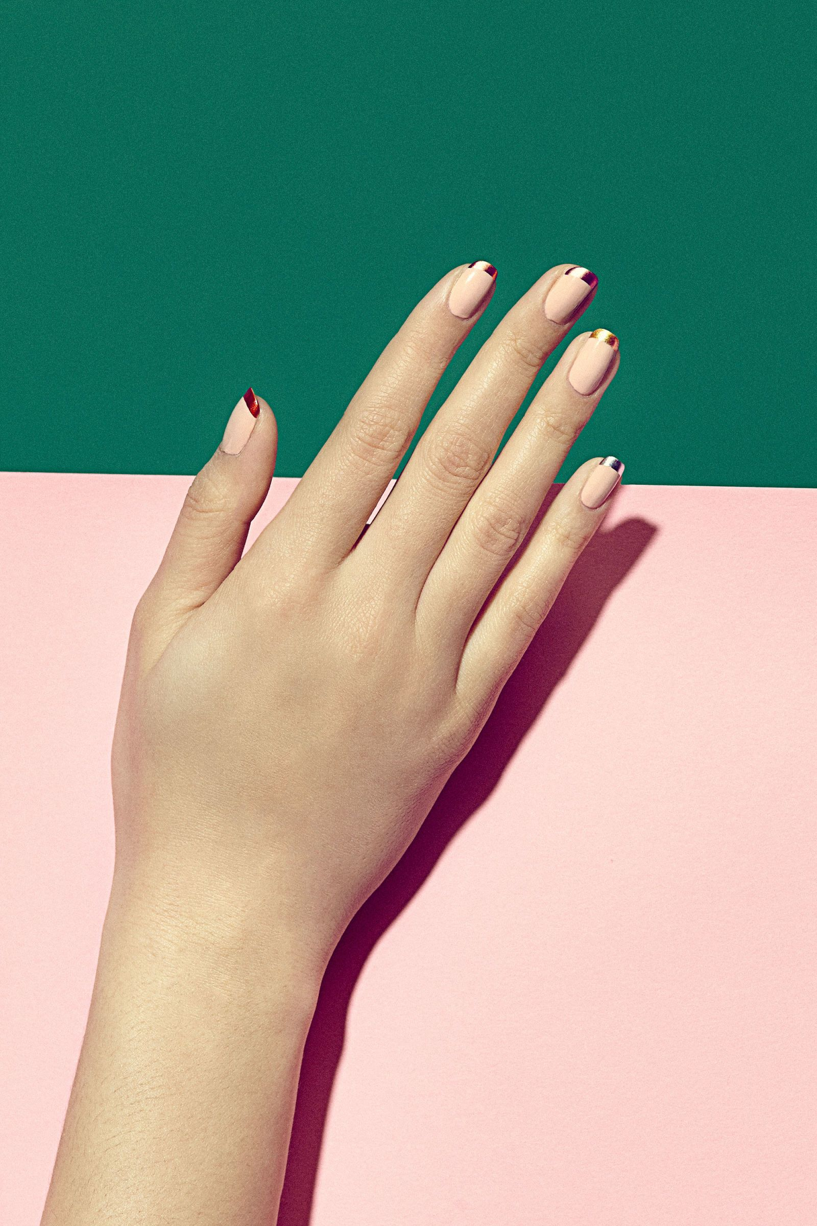 """""""It's a spin on the classic nude or French manicure but because the tips are in ombre metallics (or you can even just pick one metallic shade for all of the tips), it's on-trend without being too in your face,"""" says Kandalec. WHY YOU'LL LOVE IT: """"It's a juxtaposition of uber-feminine polish colors with some edginess from the reflective tips,"""" she says. """"The metallic tips make a nude manicure look more expensive, vibrant and luxe."""" THE PAINTBOX HOW-TO: 1. Polish the nail in two coats of the…"""