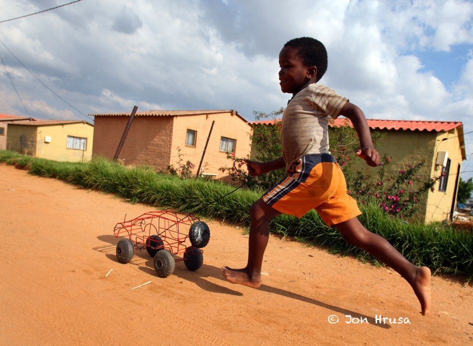 Toys From Africa : Six year old motlalepule chabedi plays with a toy car made