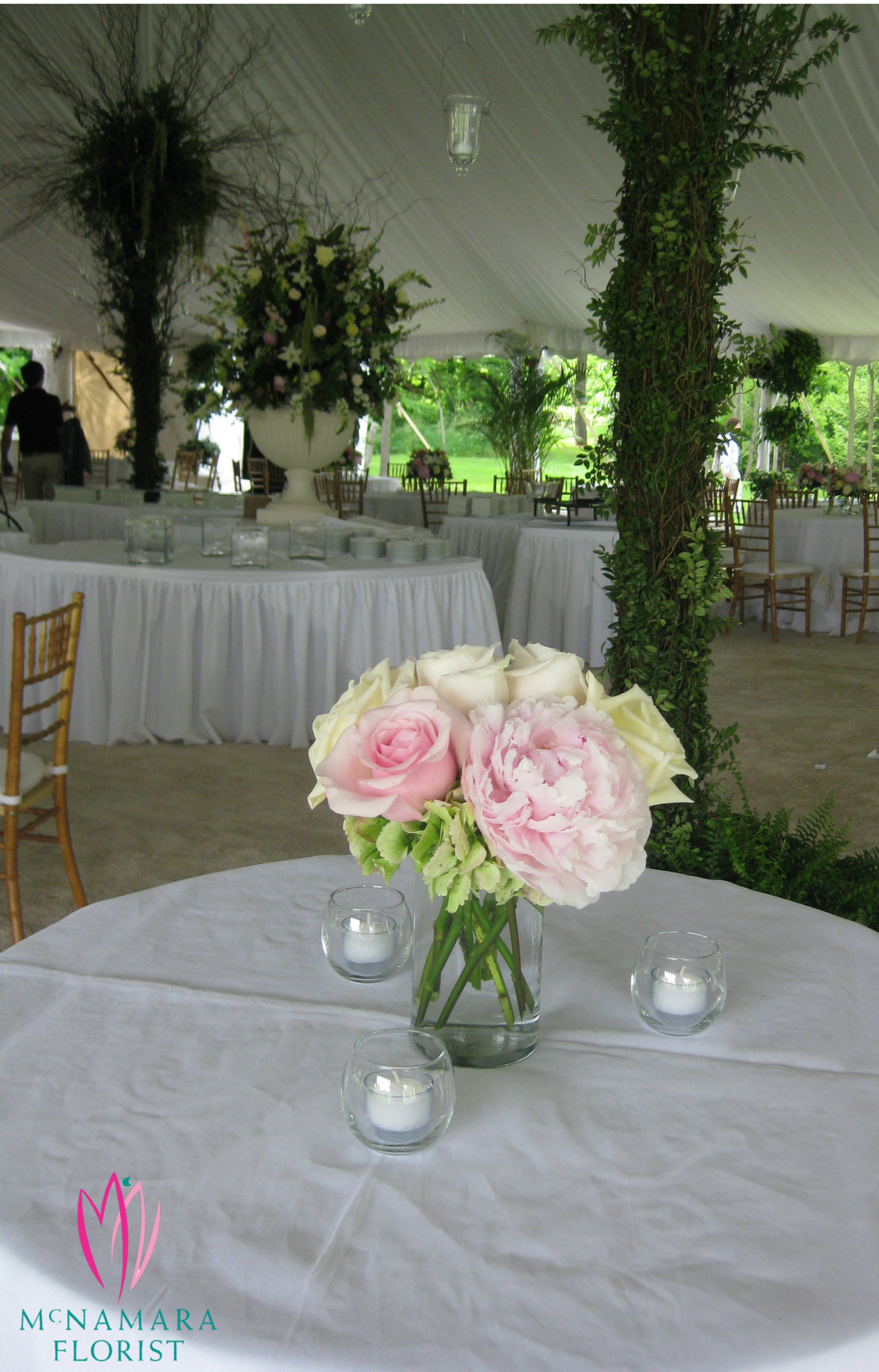Roses And Peonies In Low Floral Arrangement As Centerpiece