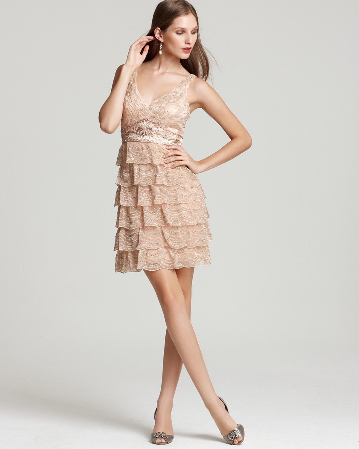 A tiered ruffled skirt lends a flirty edge to this otherwise possible wedding guest dress ombrellifo Images