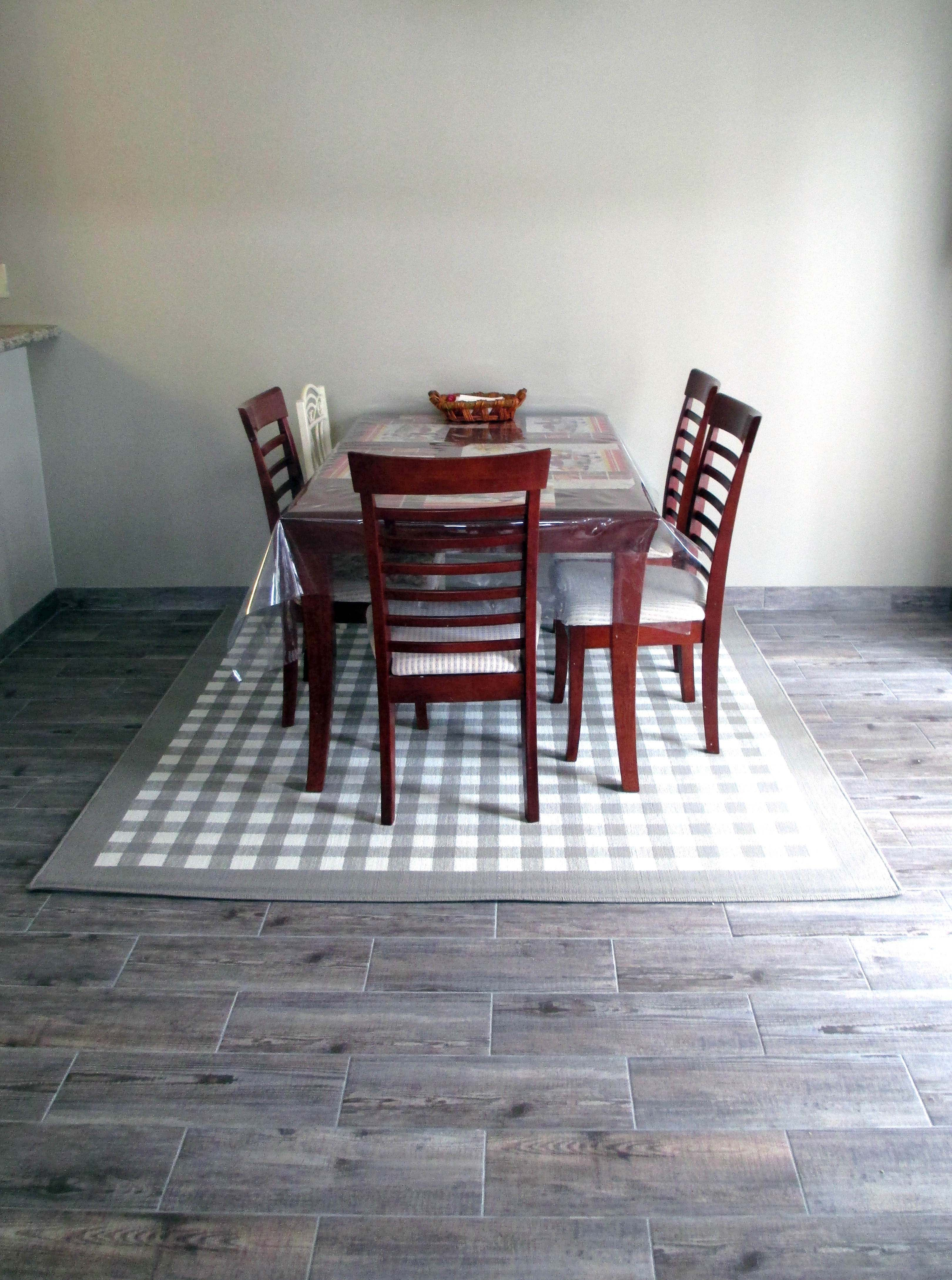 A tile that looks like hard wood you dont have to worry about it bayur borneo wood look floor tile 7 x 20 in dailygadgetfo Choice Image