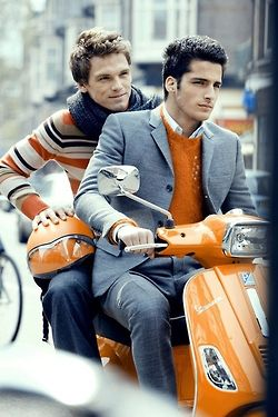 Orange outfits on an orange Vespa!