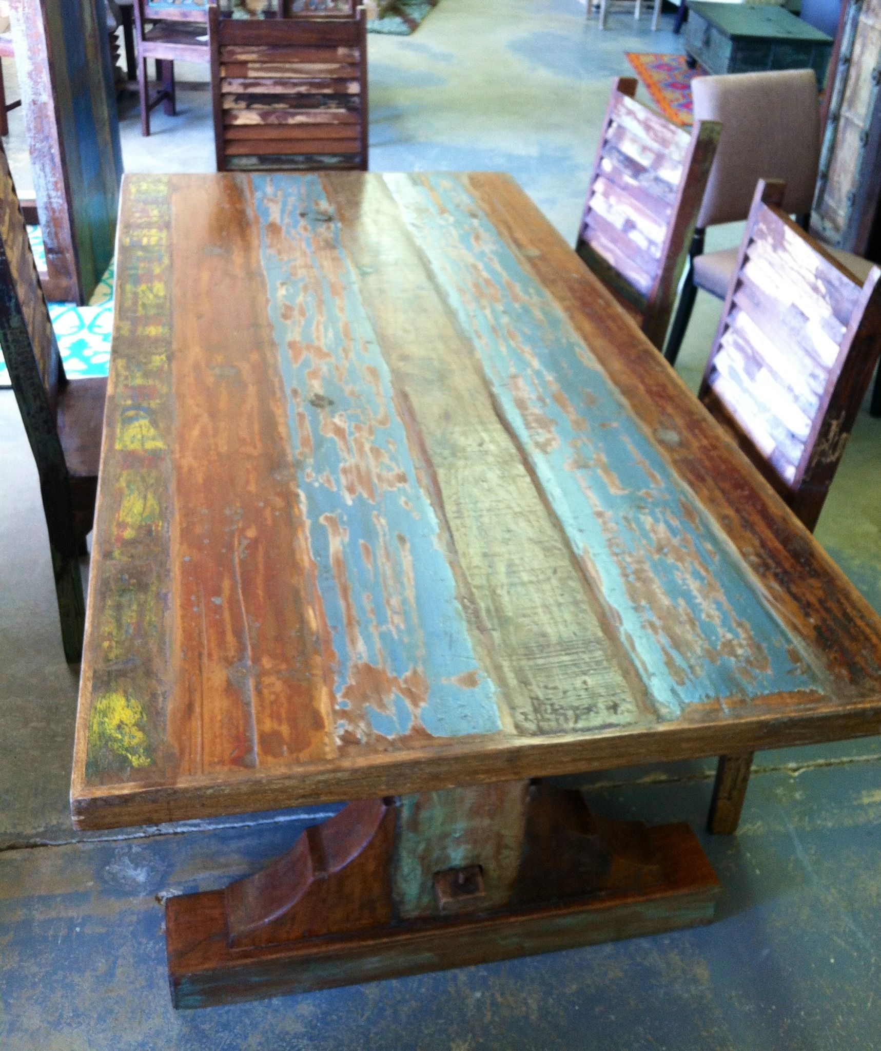 Quot table with weathered paint finishes on the reclaimed