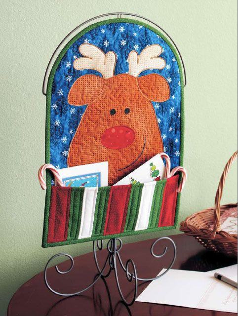 This adorable holiday character is the perfect keeper of the Christmas cards and candy canes.