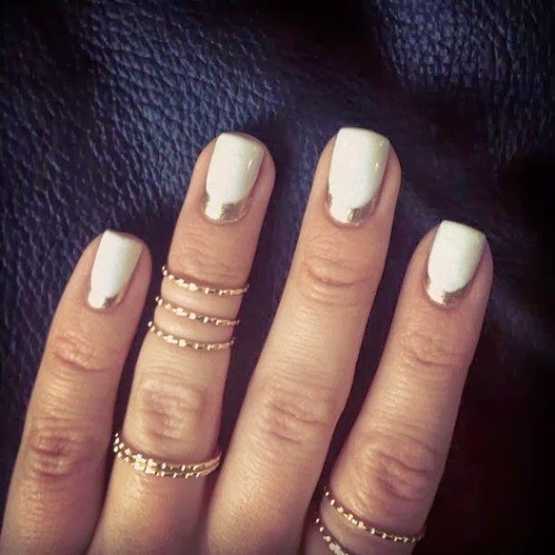A perfect white mani embellished with gold cuticle crescents ...