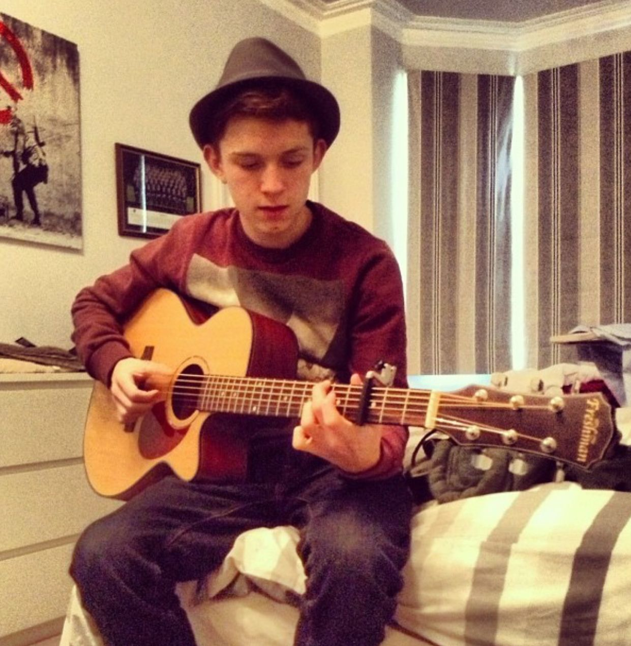 He can play the guitar?!!!!! I love him even more now