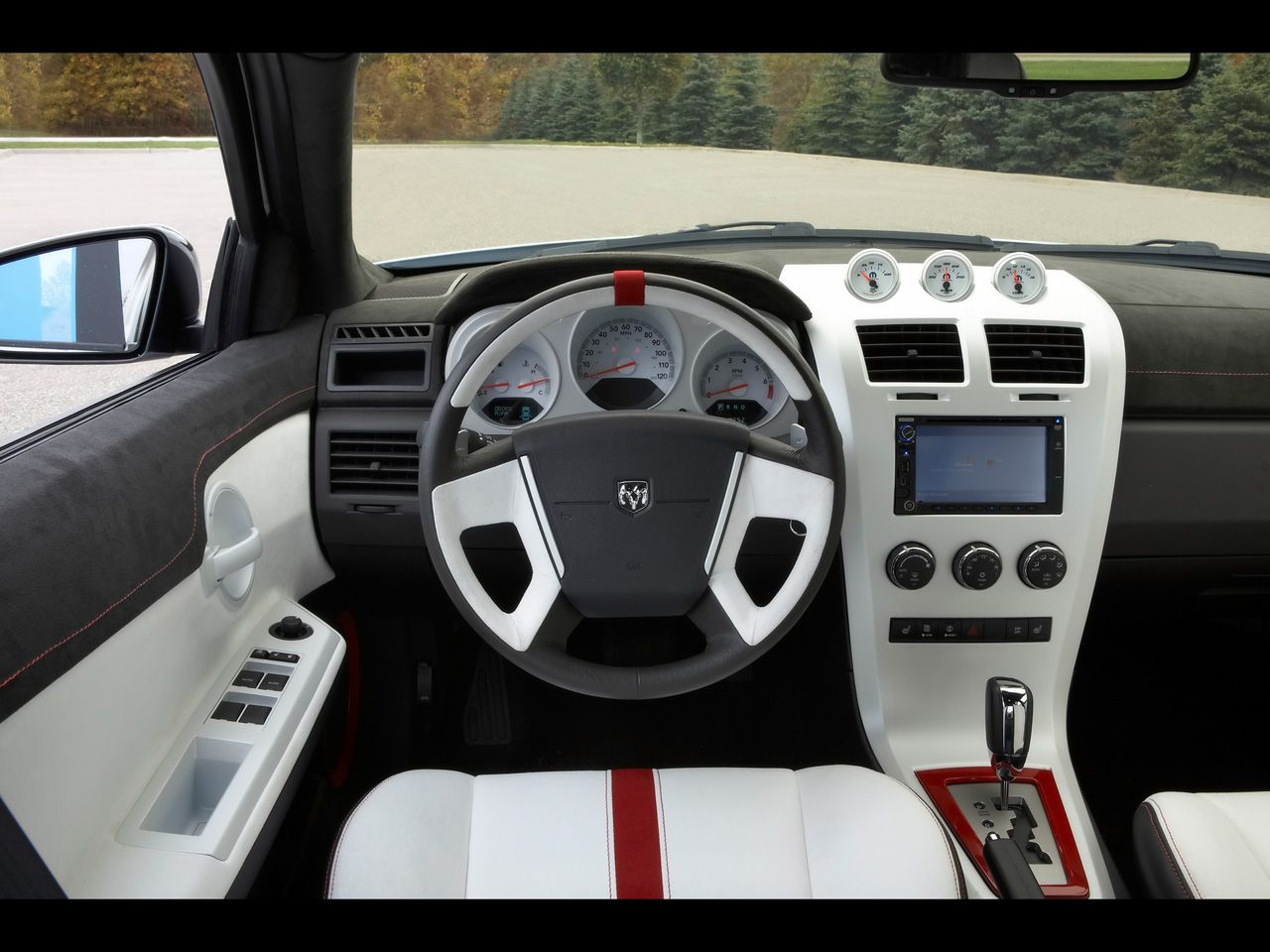 The Interior In This Dodge Avenger Omg