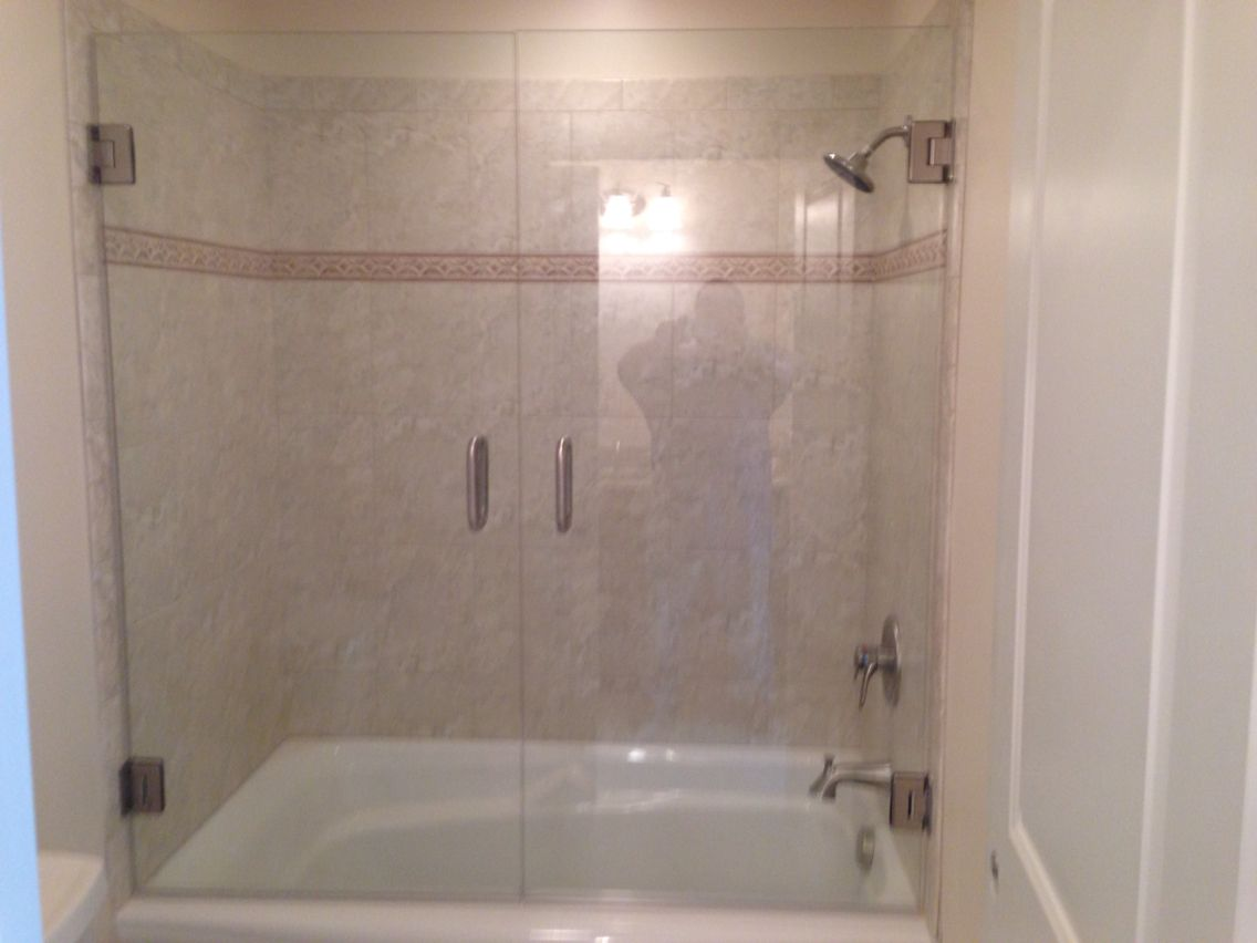 "3/8"" Frameless french doors on a bathtub. It allows easy"