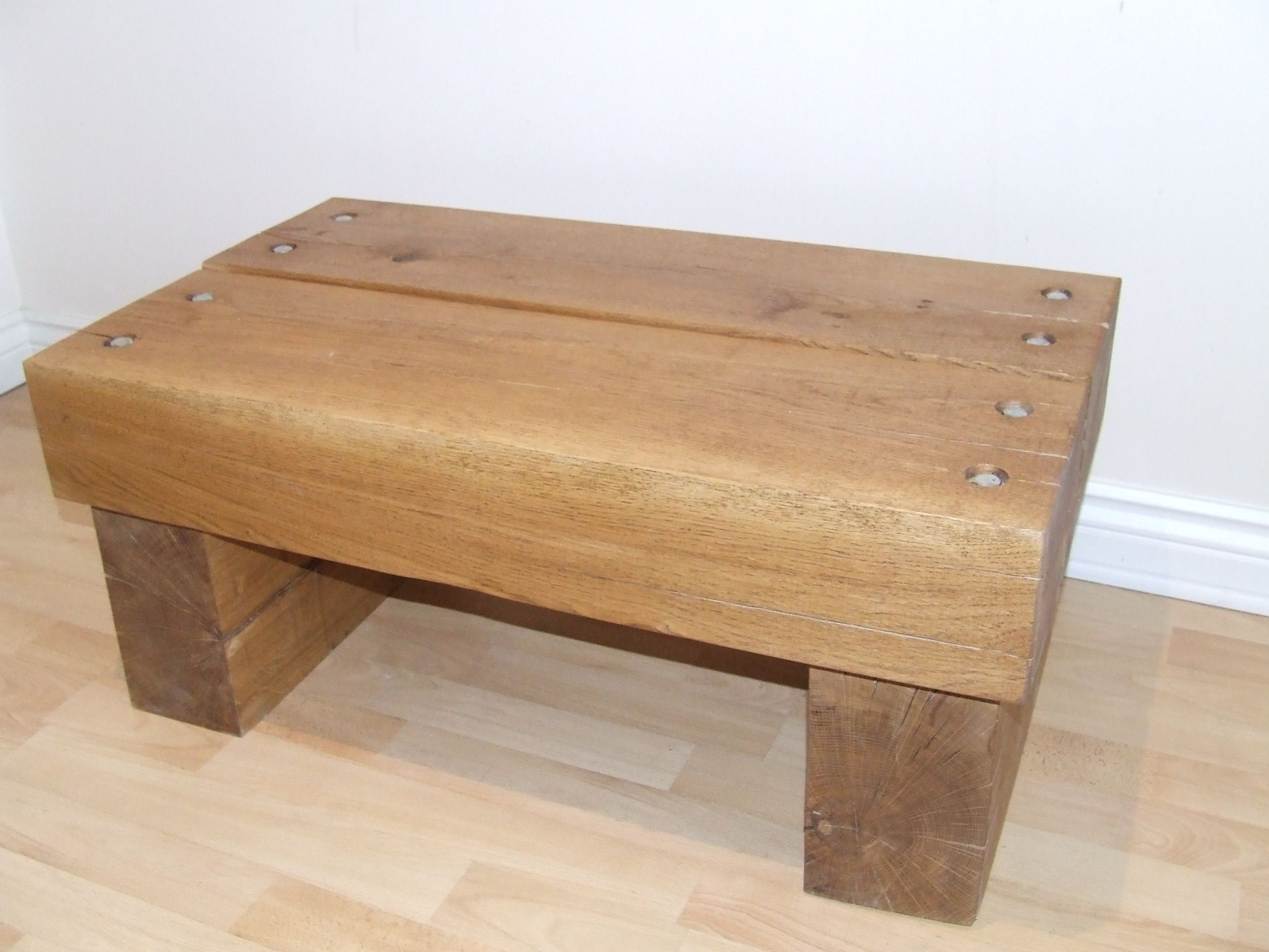 Oak sleeper coffee table with a sleek finish oak sleeper tables oak sleeper coffee table with a sleek finish geotapseo Gallery