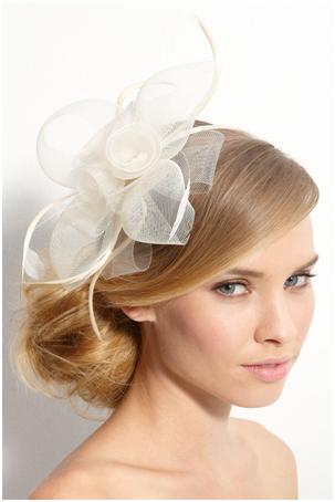 Bridal fascinators. Why can t he like veils ! UGH.  35c572e2aa5