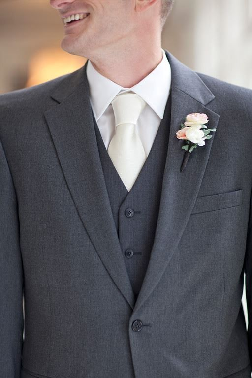 Ivory dress with a groom wearing a White Tuxedo jacket... | White ...
