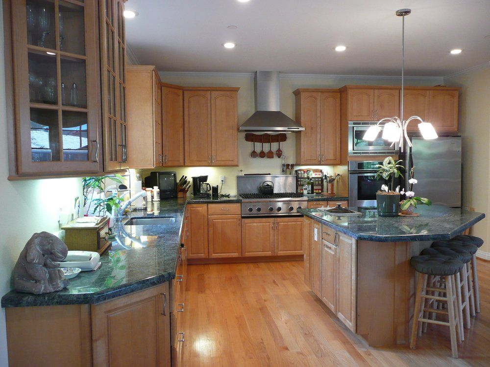 Kitchen with maple cabinets, granite counter tops and red ... on Natural Maple Cabinets With Quartz Countertops  id=84854