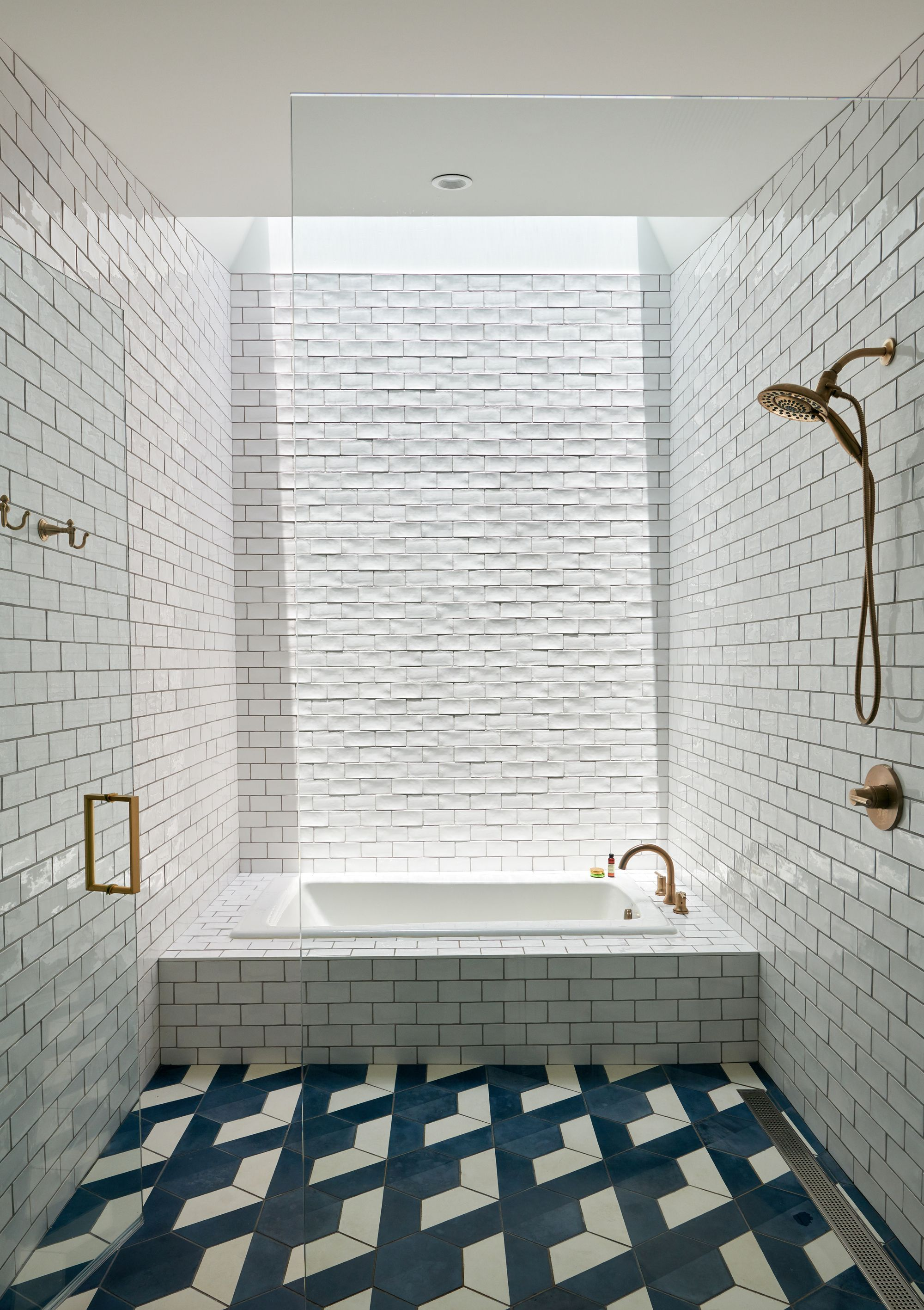 Naturally Lit White Tiled Bathroom With