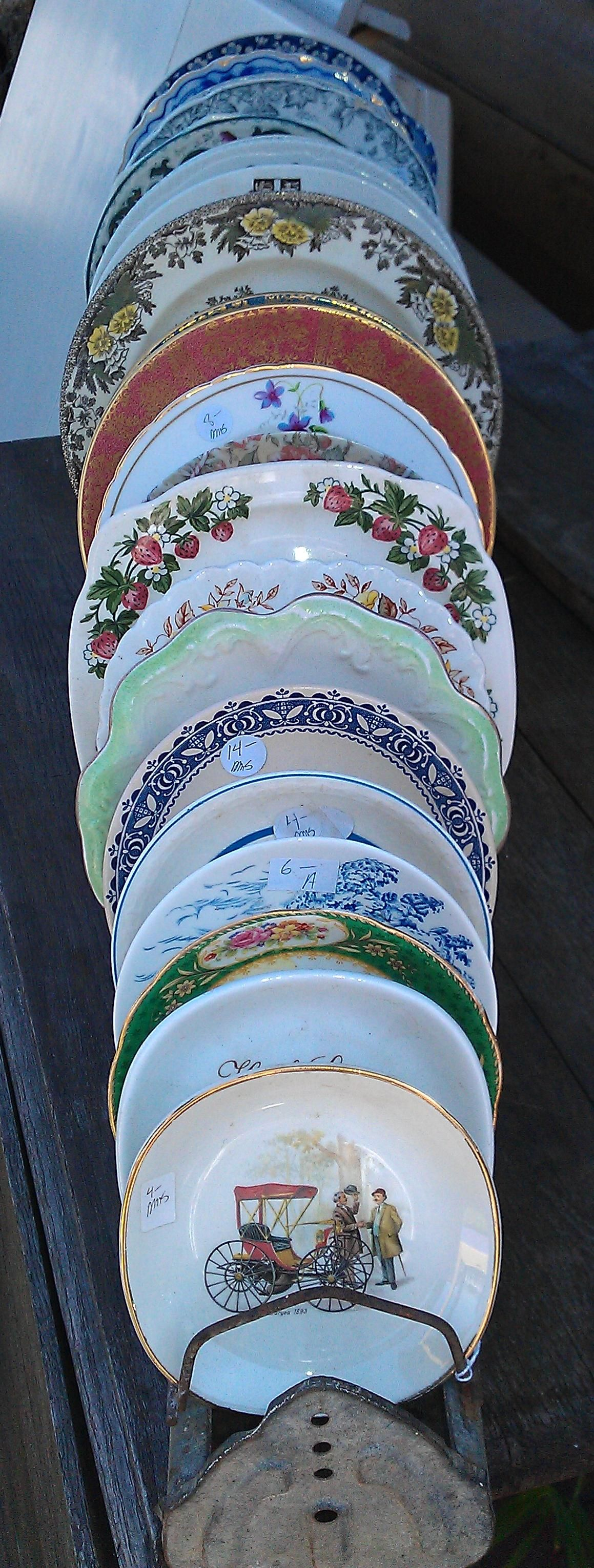 vintage china plates displayed in an antique chicken