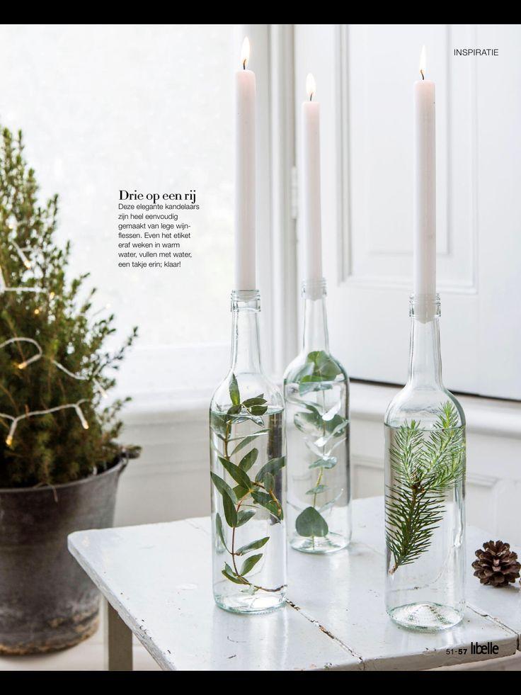 Glasflaschen gefüllt mit Wasser und Zweigen als Kerzenhalter #christmasweddingideas