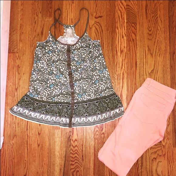NWT XS/S American Eagle Floral Peplum Tank Size xs but can fit a small for sure. Olive green base with white and blue floral print. Peplum style bottom. Racerback. American Eagle Outfitters Tops