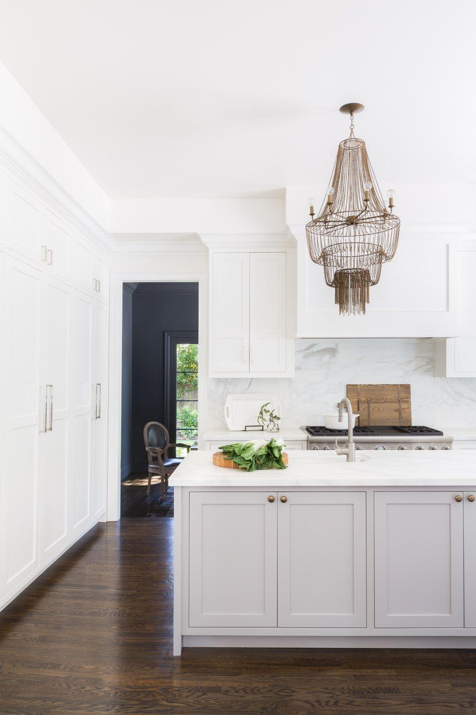 Stunning glam kitchen with statement hanging light fixture | Amanda ...