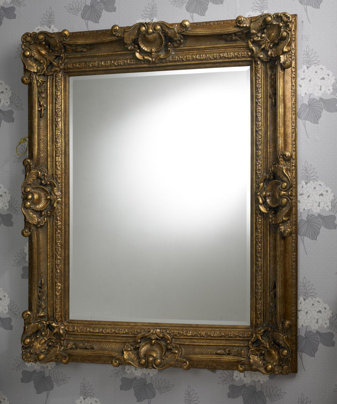 This is a handsome traditional large mirror with a classic rococo style decorative frame finished in gold; the mirror itself is made in high quality bevelled glass. Dimensions: 165cm x 135cm  http://www.totalmirrors.com/roccoco-mirrors/216-gold-rococo-mirror-165x135cm.html