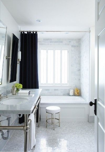 White And Grey Bathroom With Marble Subway Tile And Dark Gray