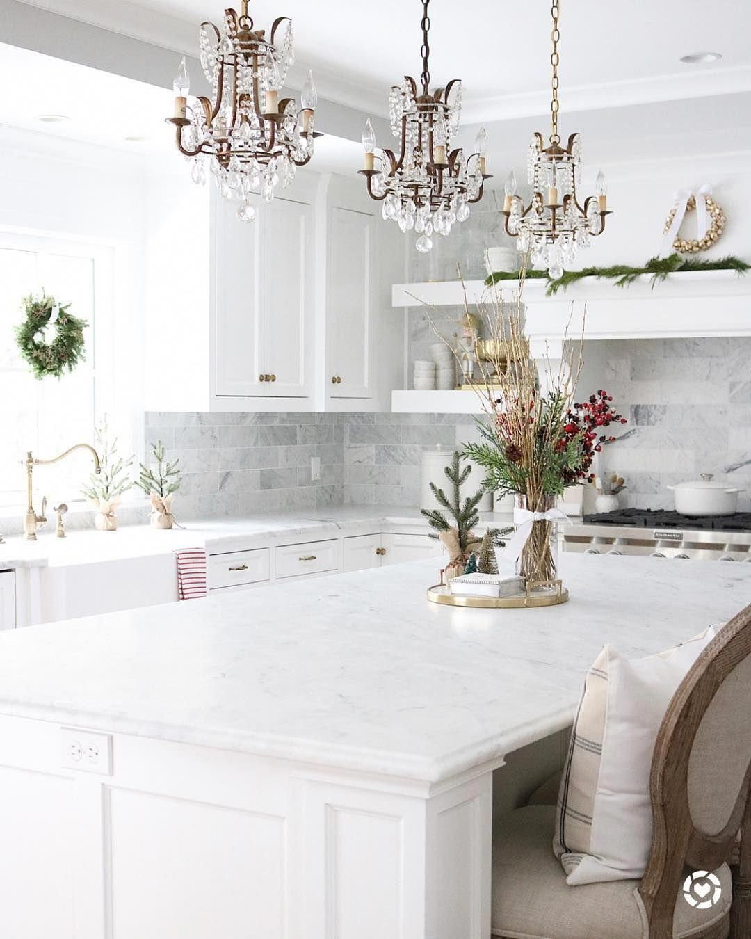 3 Crystal Chandelier Pendants Above White Marble Kitchen Island