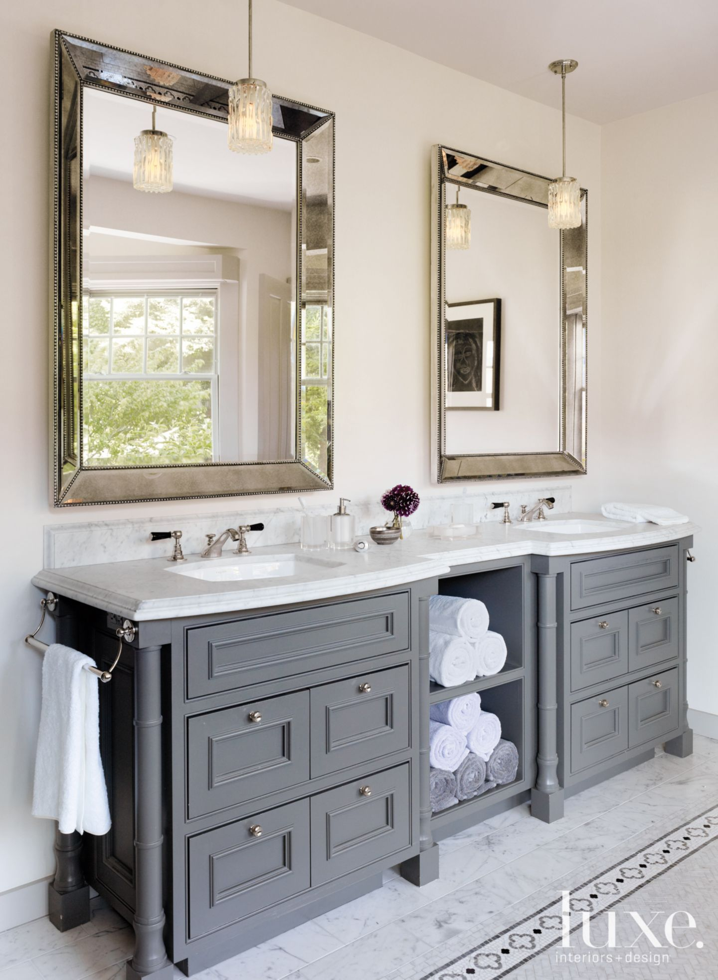 In the master bathroom rosenfeld hung a pair of for Custom bathroom vanity designs