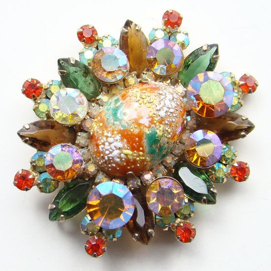 Amber and greens art glass brooch.