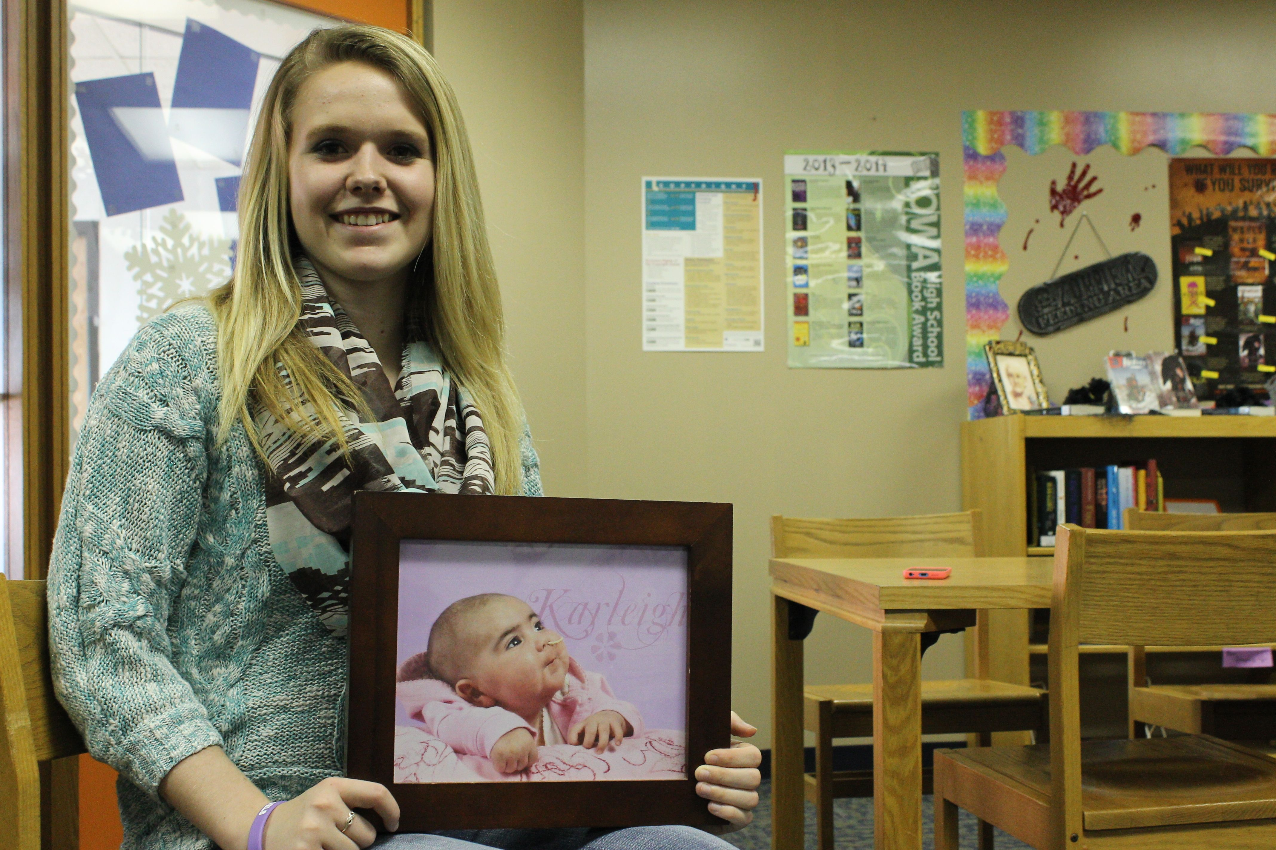 Kayla Baker, 17, is a senior at Colo-NESCO High School and is holding a bone marrow drive on Saturday, Feb. 8. Her baby sister, Karleigh, passed away in 2009 after being diagnosed with a rare white blood cell disease that required chemotherapy and a bone marrow transplant. Photo by Julie Ferrell/Ames Tribune
