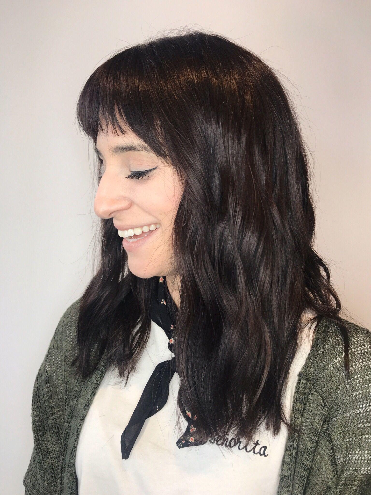 dark hair, dark wavy hair, dark hair with bangs, bangs, haircut