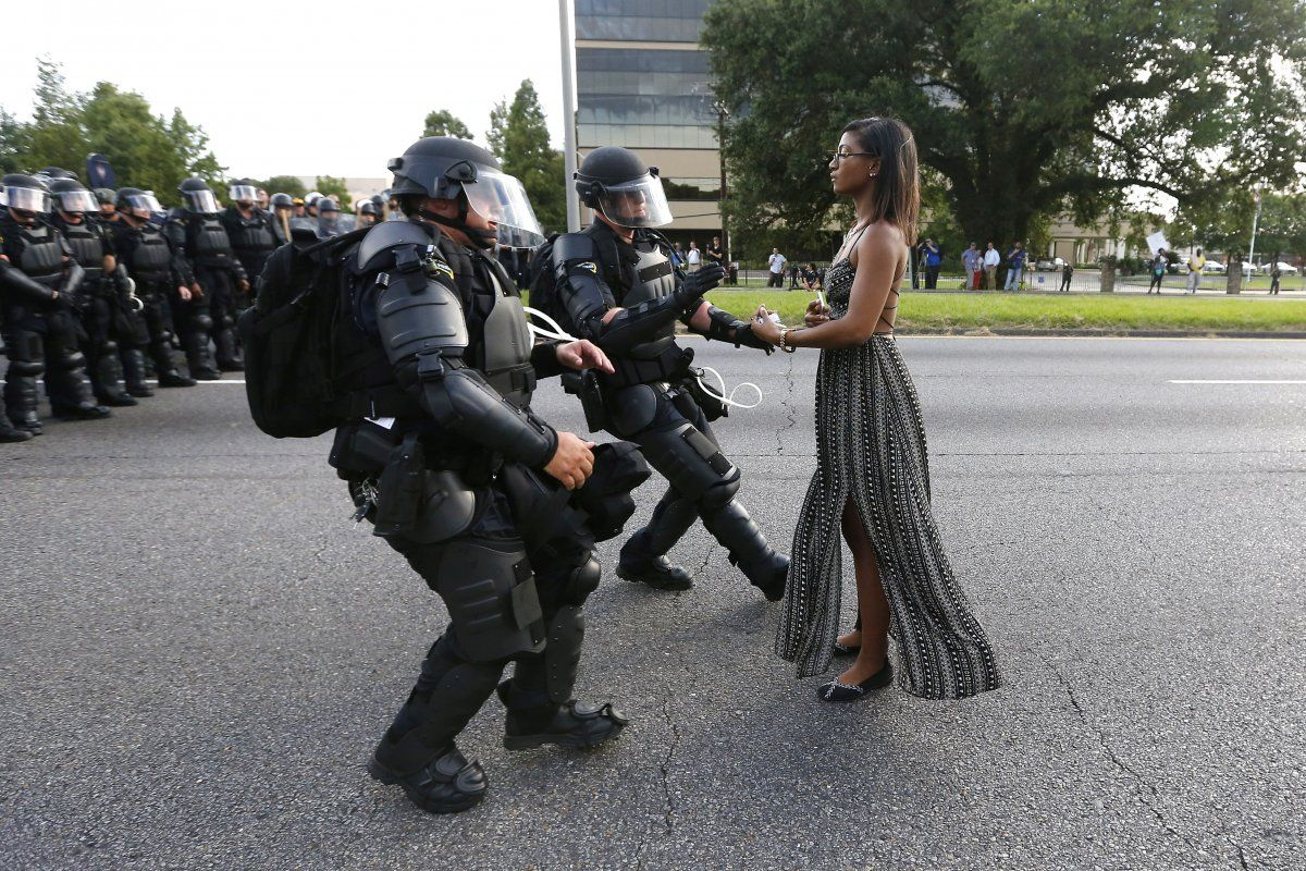 A demonstrator protesting the shooting death of Alton Sterling is detained by law enforcement near the headquarters of the Baton Rouge Police Department in Baton Rouge, Louisiana, US. July 9, 2016.