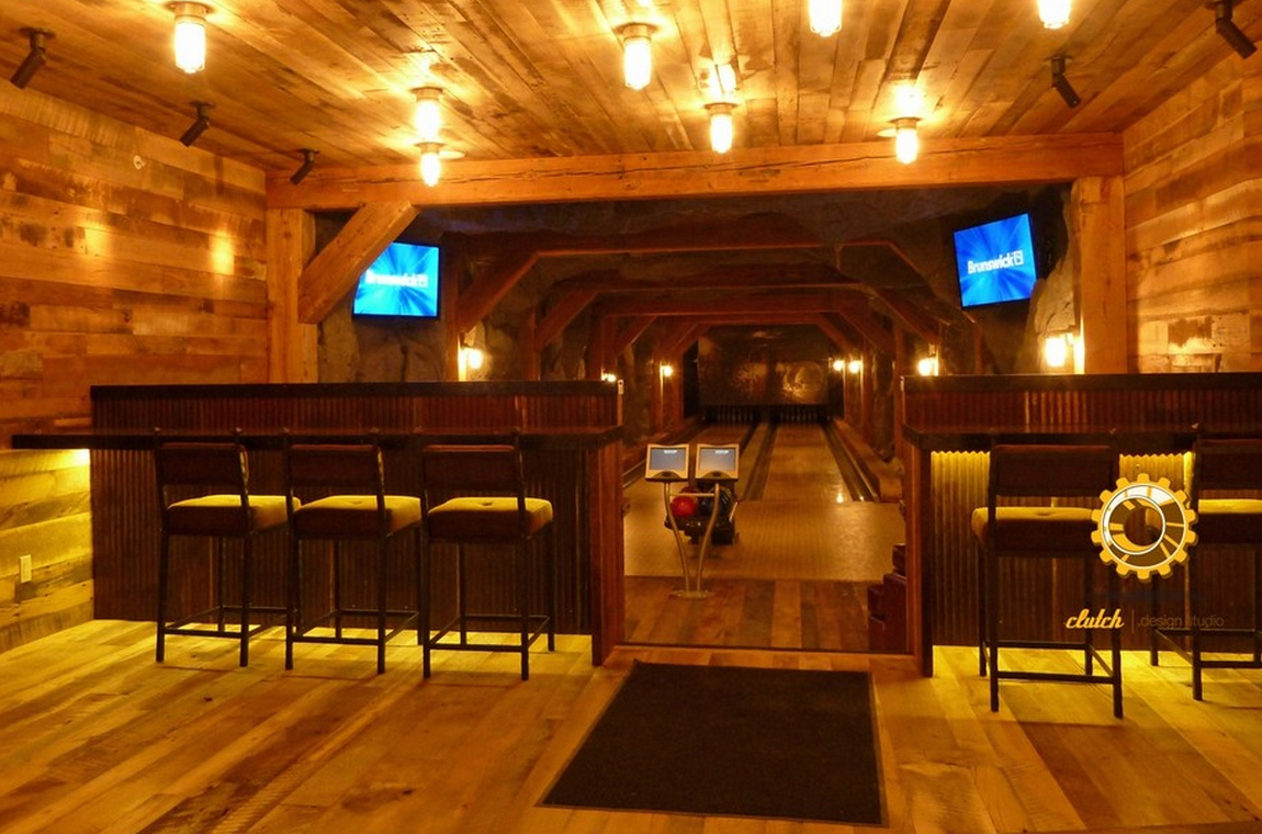 A Half Wall Separates The Bowling Alley Area From The Spectator Area Seating Provided By Bar