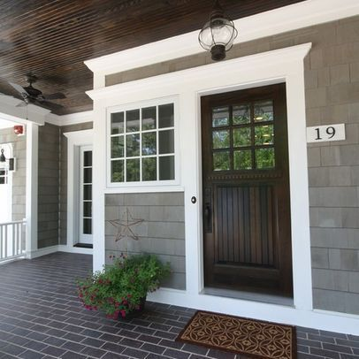 Front Door Color Ideas Check Out The Dark Stained Front Door With The Contrasting White Trimwork And Gray S House Exterior House Colors Exterior House Colors