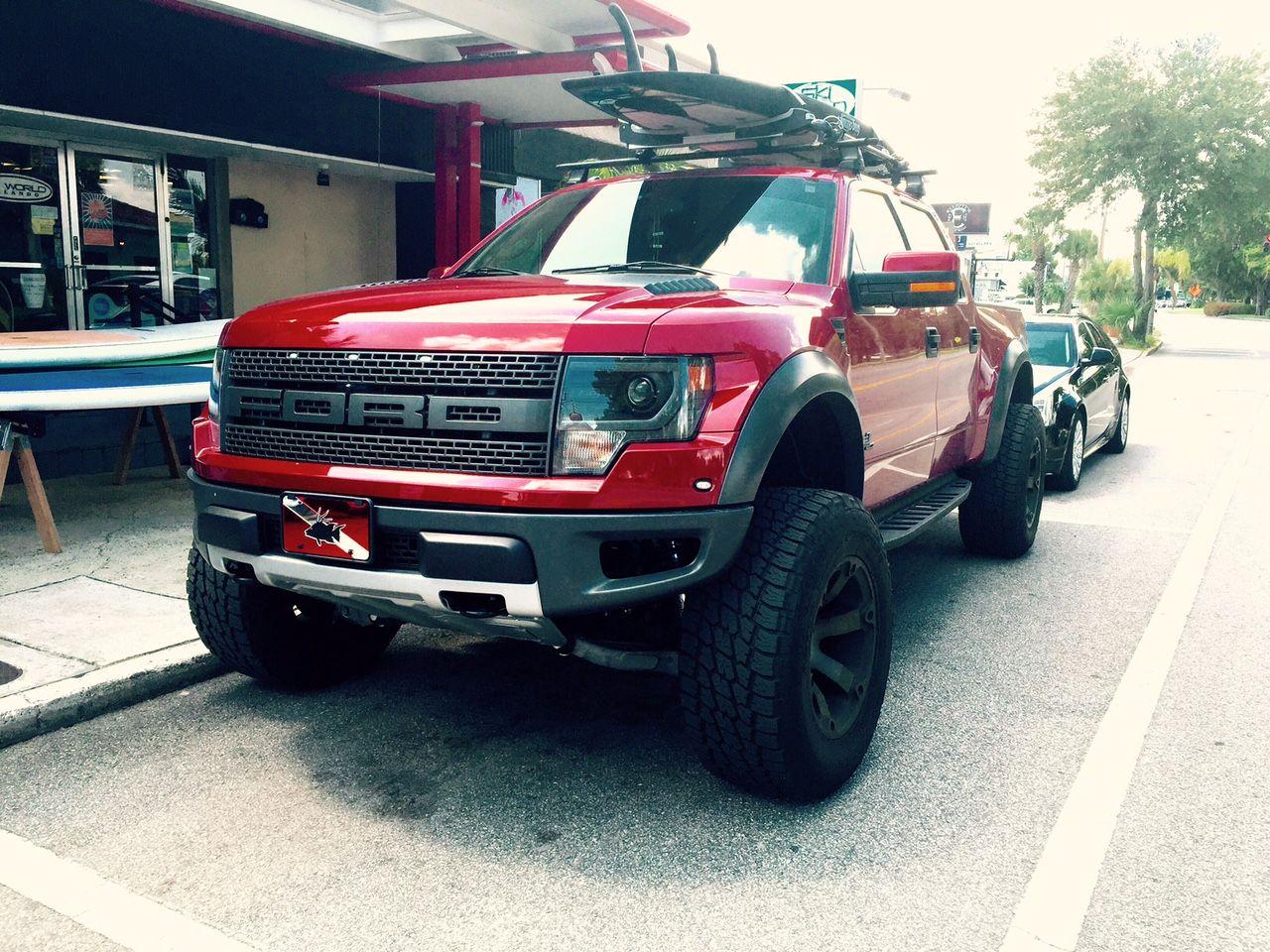 Ford Raptor By Roush With Thule Roof Rack Holding A Bote Paddleboard Ford Ranger Ford Raptor Ford Ranger Raptor